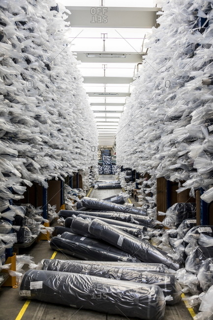 Rolls of fabric in bags in an Italian textile factory