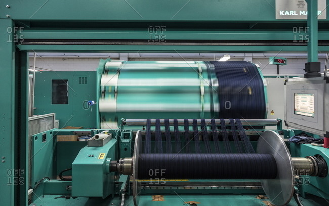 Trivero, Italy - March 1, 2017: Machine weaving textile in a factory in Trivero, Italy