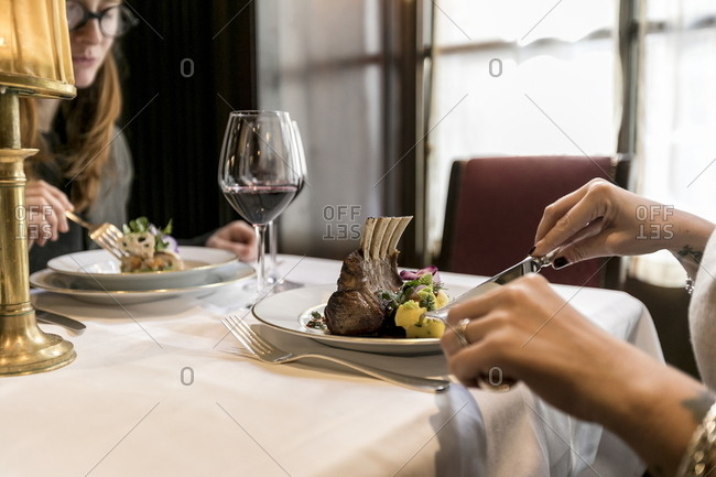 Milano, Italy - February 17, 2017: Women eating meal at the Bistrot da Giacomo