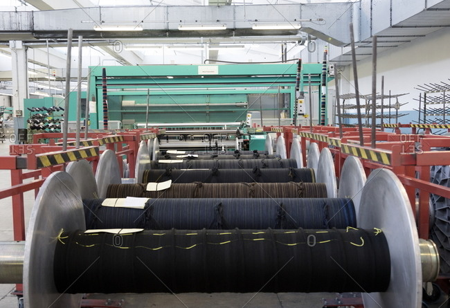 Valle Mosso, Italy - March 1, 2017: Spools of wool in a textile factory in Valle Mosso, Italy