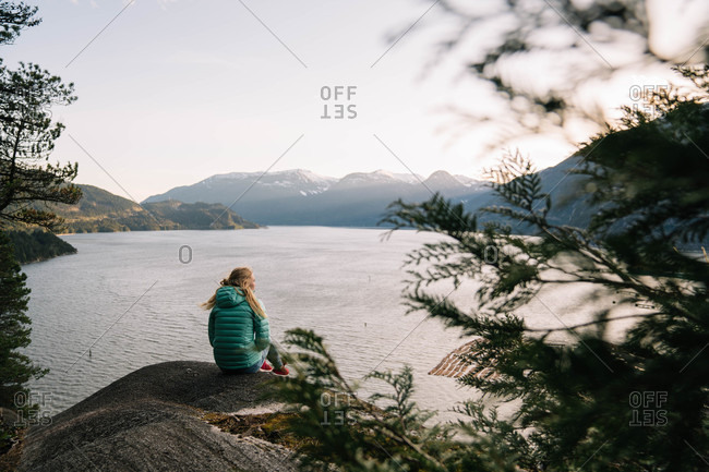 Woman on shore of a mountain lake