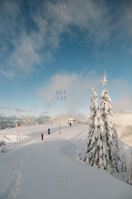 People walking on snowy mountain