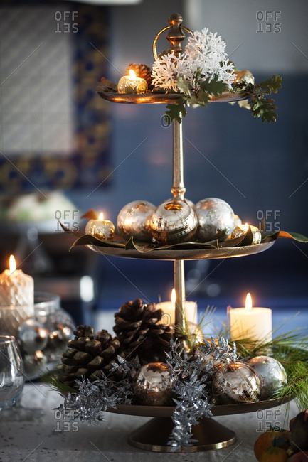 Tiered platter with holiday decorations in candlelight