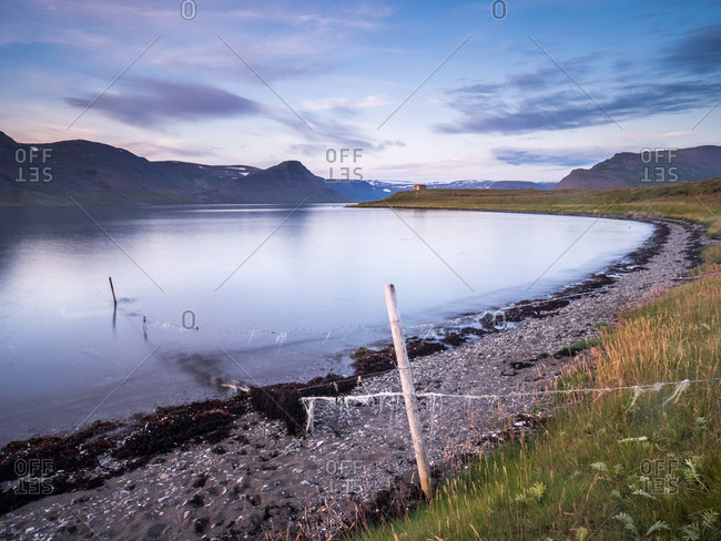 Old fence leading into water, Westfjords, Iceland