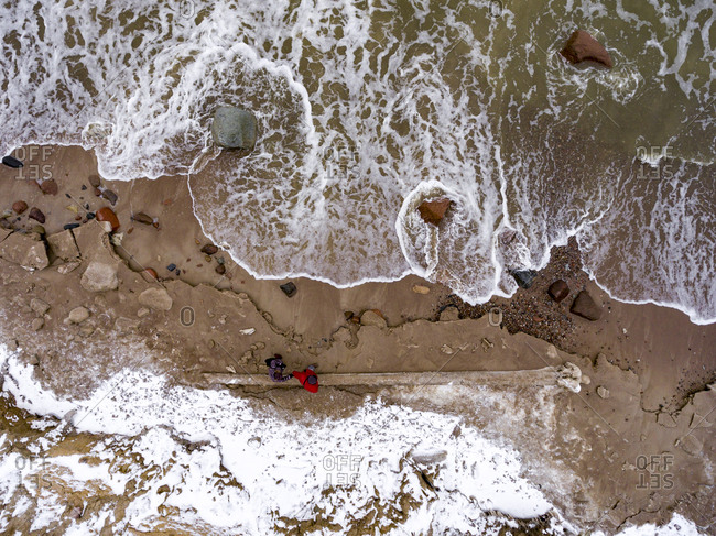 People walking on the coast of the Baltic Sea in winter Lithuania