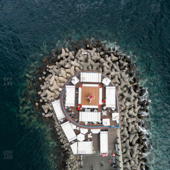Restaurant around the lighthouse on the stony pier, Gran Canaria, Canary Islands, Spain