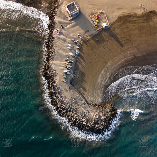 Boats on a beach on the coastline of Gran Canaria, Canary Islands, Spain