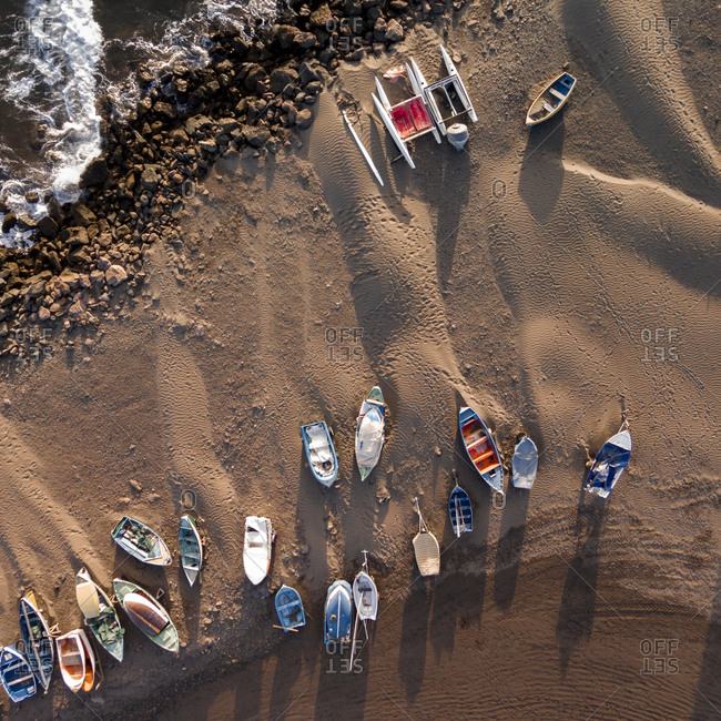Boats on a sandy beach on the coastline of Gran Canaria, Canary Islands, Spain
