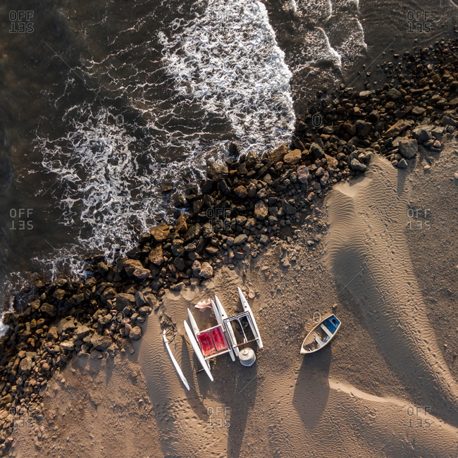 Sandy beach with boats on the coastline of Gran Canaria, Canary Islands, Spain
