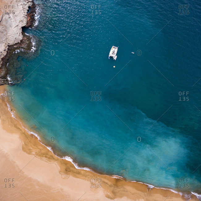 Boat off of a beach in Gran Canaria, Canary Islands, Spain