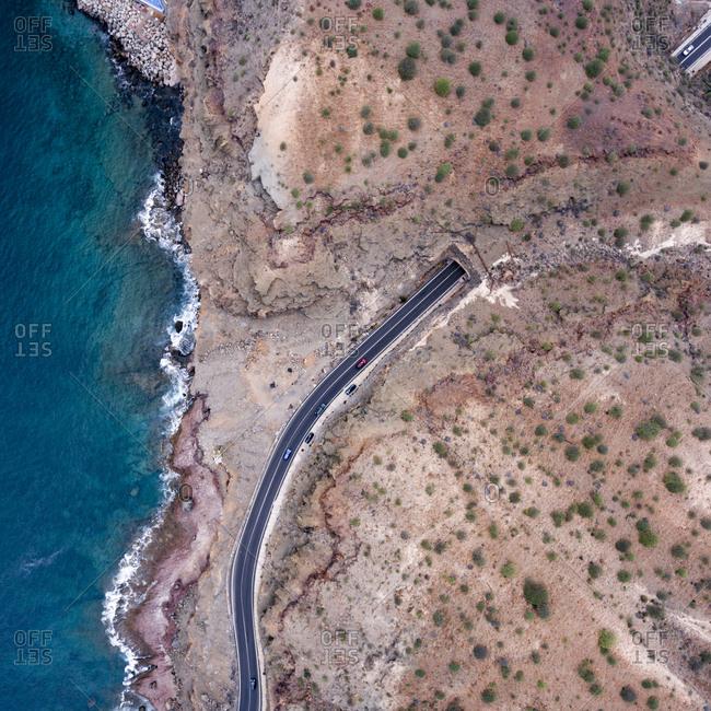 Mountain road by the ocean in Spain