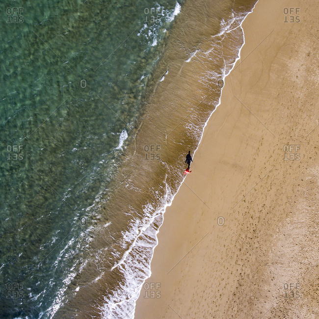 Aerial view of man walking on the beach