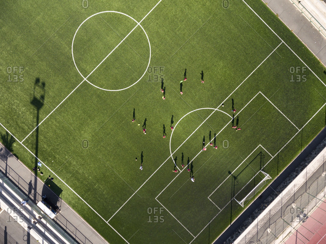 Aerial view of children at football training