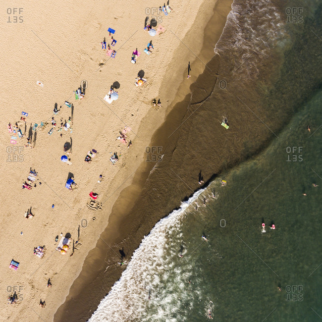 Beachgoers on Playa del Ingles in Maspalomas, Gran Canaria, Canary Islands, Spain