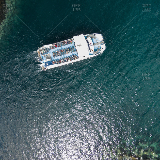 Gran Canaria, Spain - January 1, 2014: Aerial view of a ferry boat in blue waters