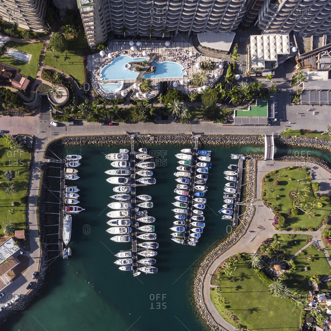 Gran Canaria, Spain - November 10, 2016: Aerial view of a marina and swimming pool at a luxury resort