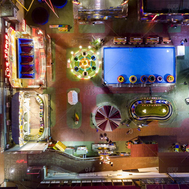 Gran Canaria, Spain - November 7, 2016: Aerial view of rides at an amusement park at night