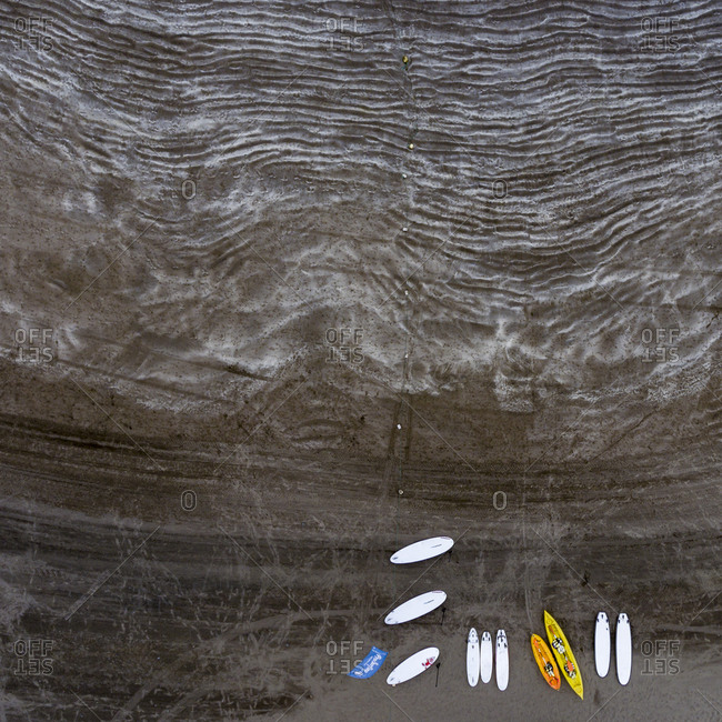 Maspalomas, Spain - November 21, 2016: Aerial view of kayaks and paddleboards on a rippled sandy beach