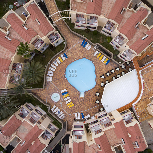 Maspalomas, Spain - November 21, 2016: Aerial view of a swimming pool between condo buildings