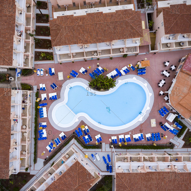 Maspalomas, Spain - November 21, 2016: Aerial view of a resort swimming pool surrounded by lounge chairs