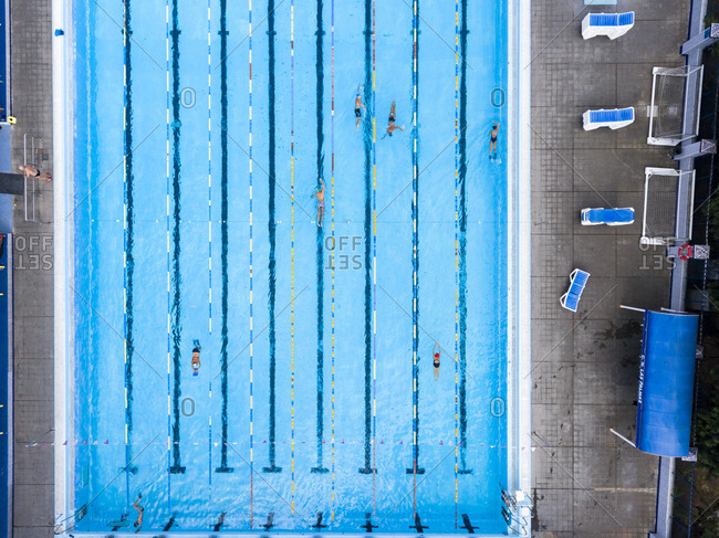 Las Palmas, Spain - November 23, 2016: Aerial view of swimmers doing laps in a swimming pool