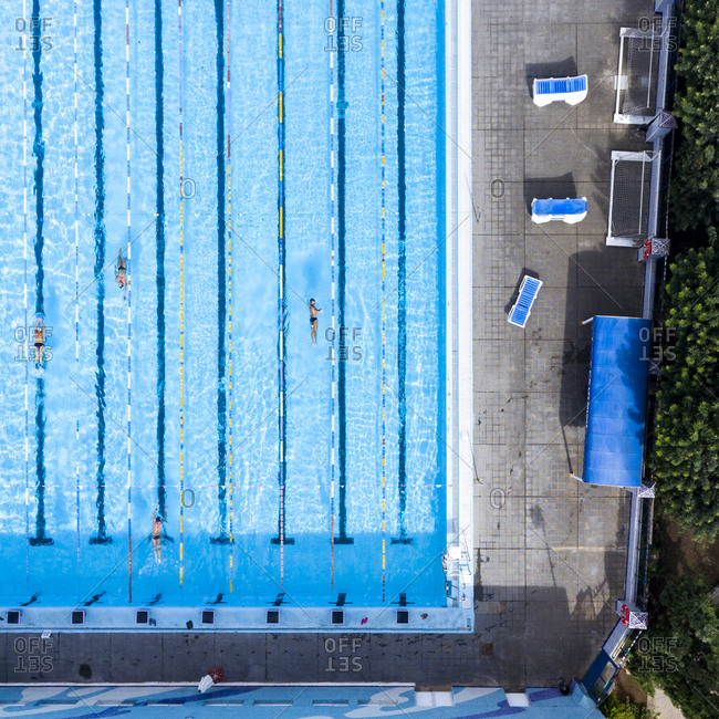 Las Palmas, Spain - November 23, 2016: Aerial view of swimmers in a pool doing laps