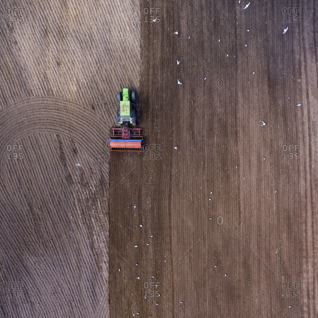 Aerial view of a tractor plowing a field