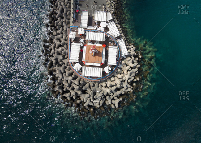Aerial view of restaurant around the lighthouse on the stony pier, Gran Canaria, Canary Islands, Spain