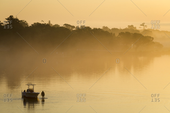 Beached fishing boat at sunrise