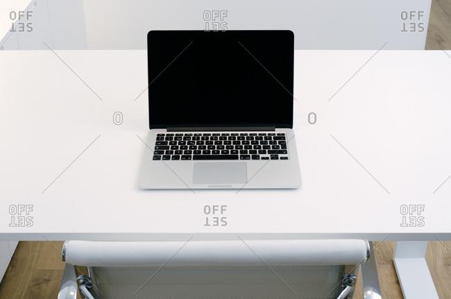 Detail of a computer on a plain desk