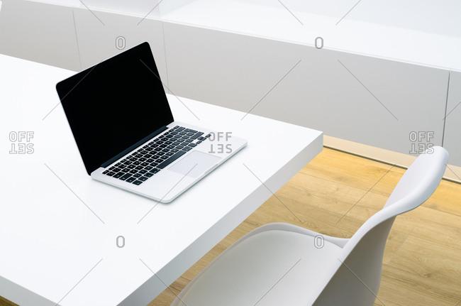 Computer sitting on white office desk