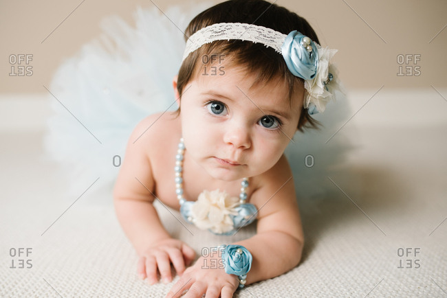 Portrait of a baby girl dressed up with fancy accessories