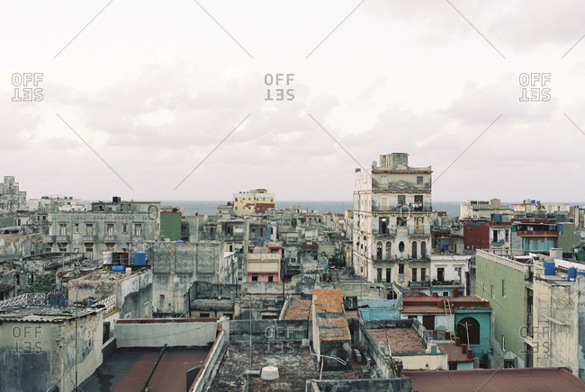 View of buildings in Cuban city by the sea