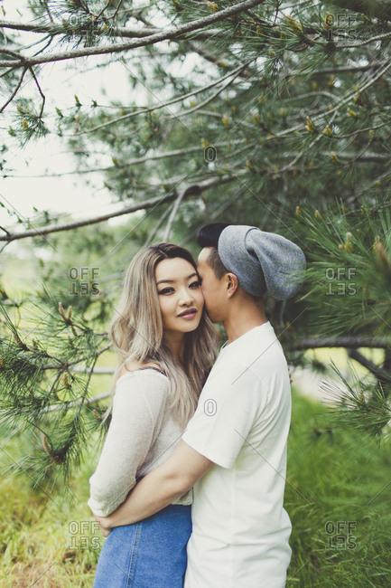 Millennial couple embracing