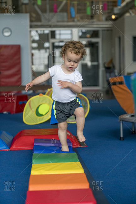 Toddler playing in children's gym