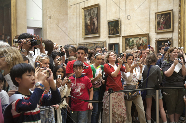 Paris, France - July 11, 2009: People photographing Mona Lisa in Louvre