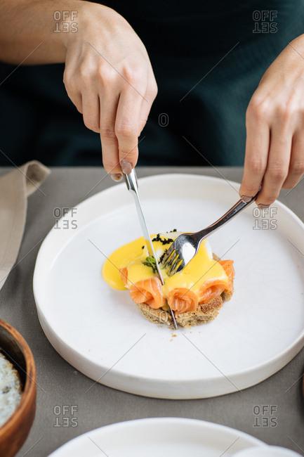 Woman eating salmon and eggs dish