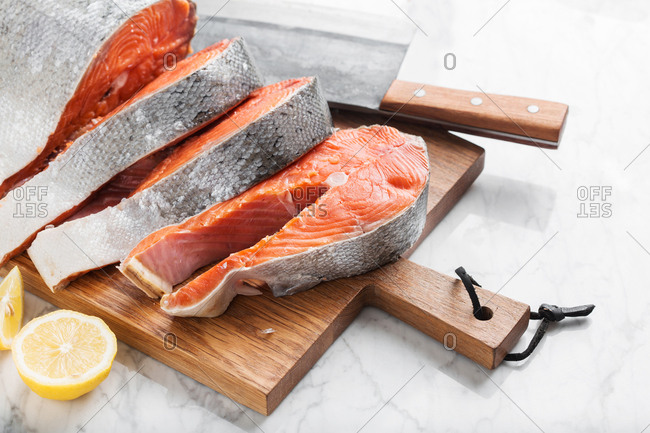 Salmon being chopped into slices