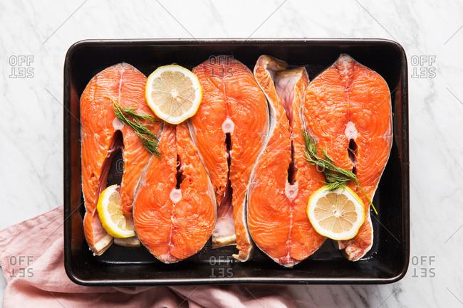 Raw salmon and seasonings in dish