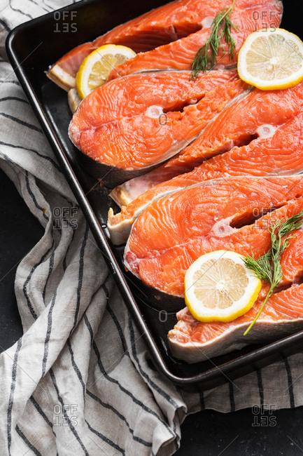 Raw salmon and seasonings in a dish