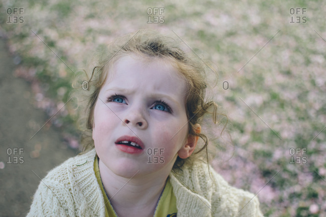 Girl with blue eyes looking up