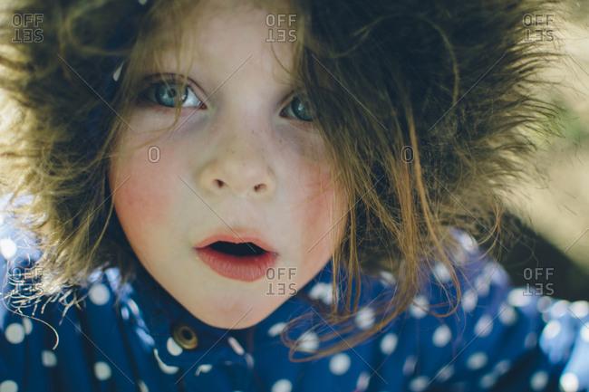 Child in polka dot fur lined coat