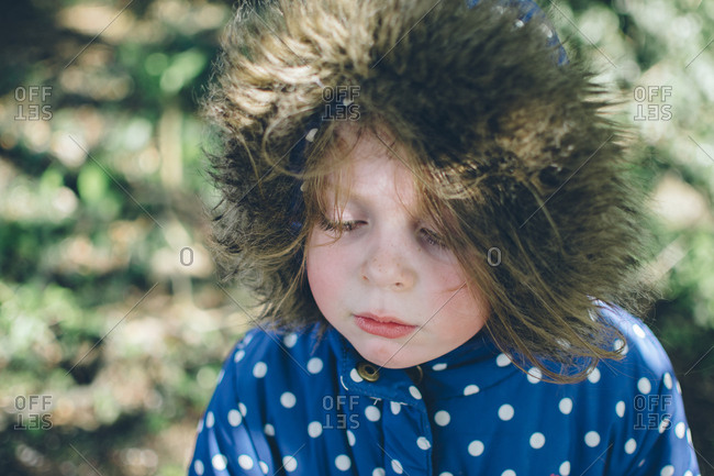 Child in fur lined polka dot coat