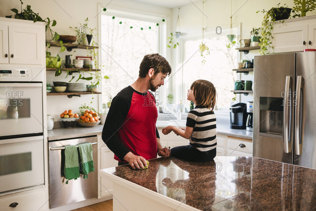 Father taking care of daughter in kitchen
