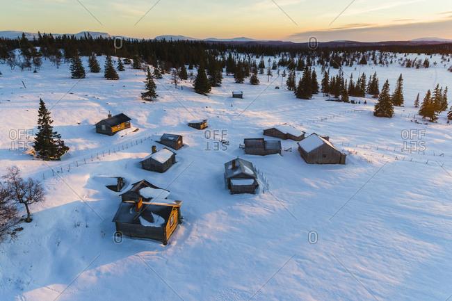 Wooden shacks in winter landscape
