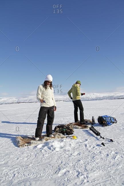 Women preparing for ice fishing