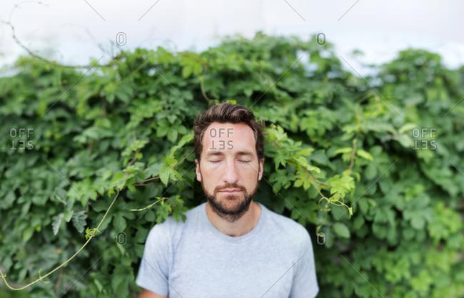 Man with shut eyes