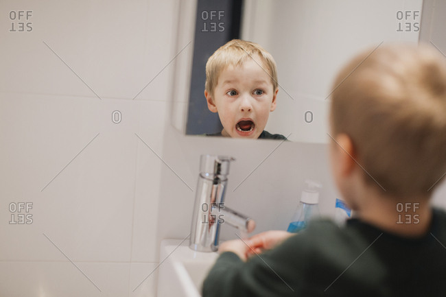 Boy reflecting in mirror