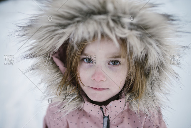 Girl in fur lined snowsuit outdoors