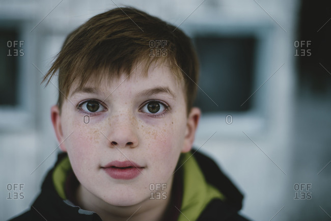 Close up of boy with dark eyes outside
